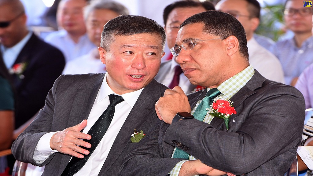 Prime Minister Andrew Holness (right) in discussion with Chinese Ambassador to Jamaica, Tian Qi, during the official launch of the Southern Coastal Highway Improvement Project (SCHIP) in Yallahs, St Thomas on Saturday.