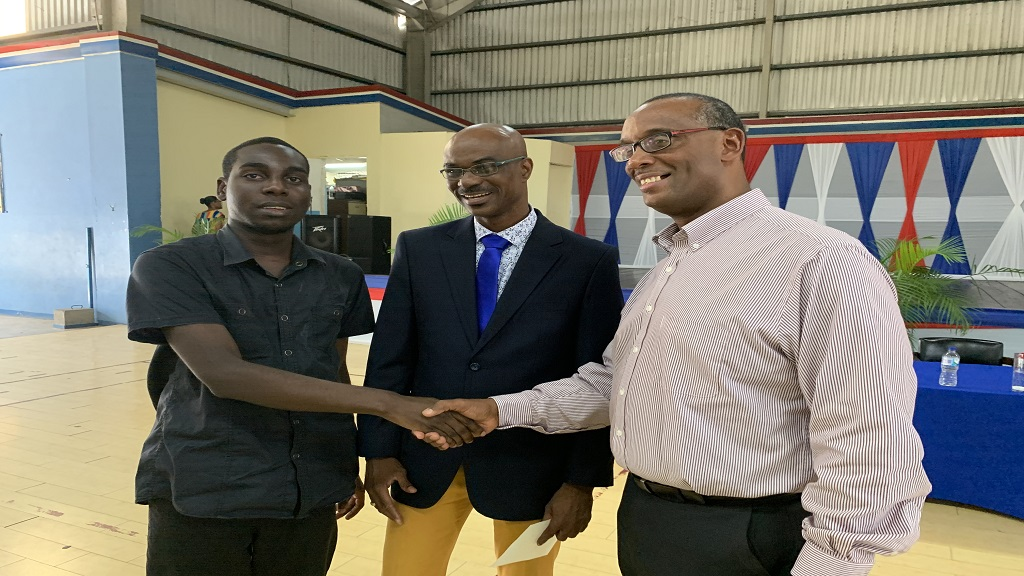 Kingston YMCA beneficiaries Jamiel Forrest (left) and Dr Howard Harvey (centre) chatted with Kingston YMCA chairman Alan-Roy Marsh at the launch of the century celebrations on Wednesday.