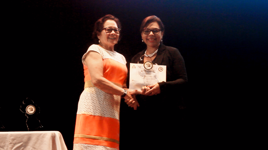 CAL Senior Marketing Manager Alicia Cabrera receives an award from Guyana's First Lady