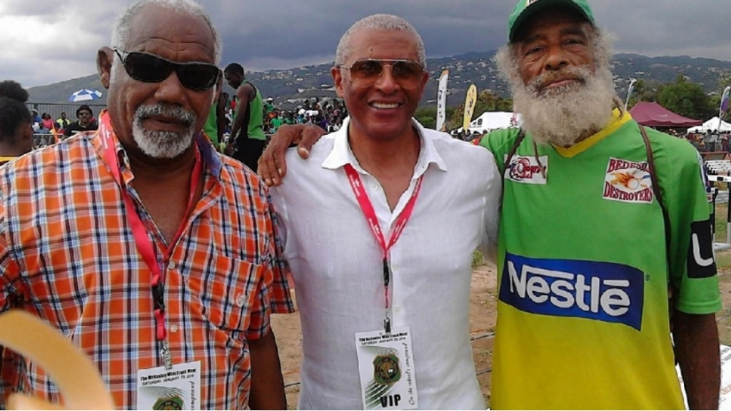 Michael Fray (right) seen here with fellow Olympian Dennis Johnson (extreme left) was found dead in Kingston on Wednesday morning.