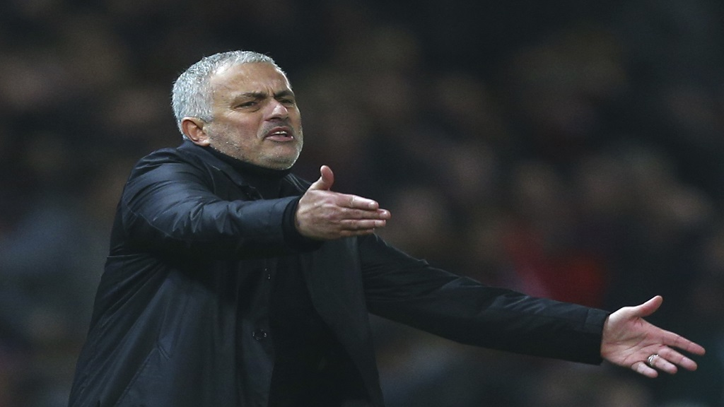 In this Wednesday Dec. 5, 2018 file photo Manchester United's coach Jose Mourinho gives directions to his players during the English Premier League football match against Arsenal at Old Trafford stadium in Manchester, England.  (AP Photo/Dave Thompson, File).