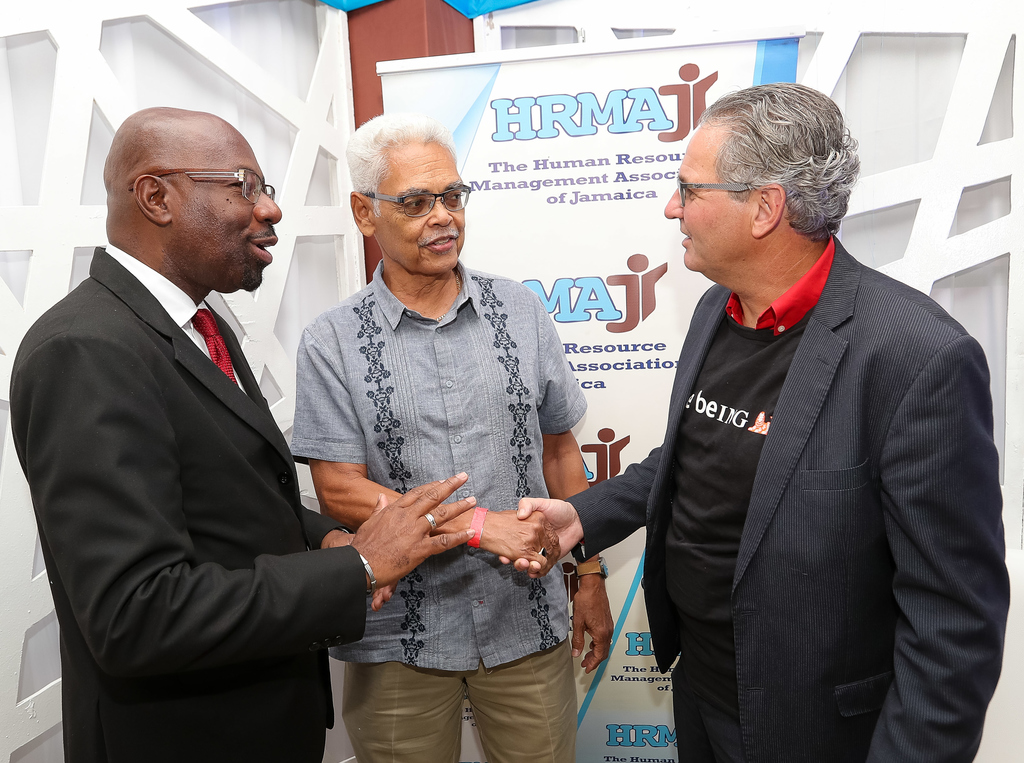 Karl Williams, (left), President, Human Resource Management Association of Jamaica (HRMAJ) engages in conversation with Donald Ward Mills (centre), recipient of the 2018 HRMAJ Icon Award and Dr. Manfred van Veghel, Director/Founder – Ecosense Consulting at the 2018 Conference 38 HR & Leadership Conference.