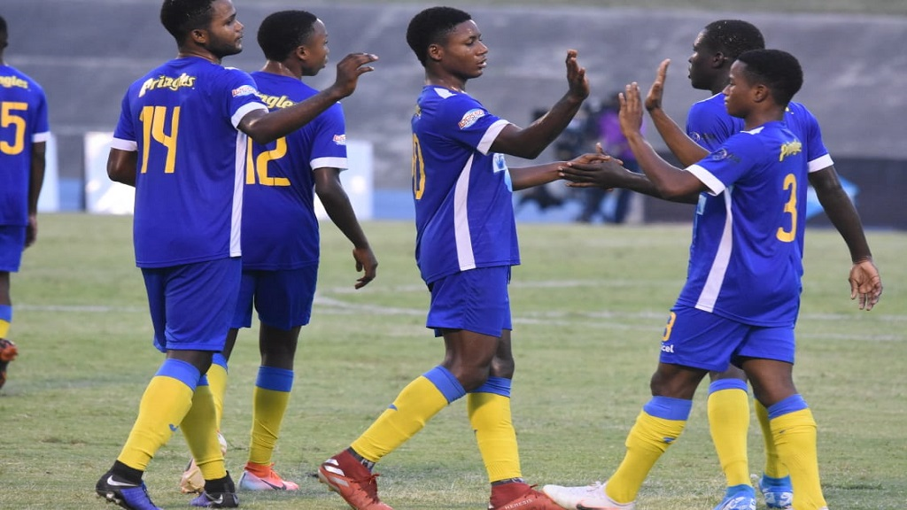 Clarendon College's striker Rodrick Granville (No. 14), who scored two goals, celebrates with teammates following the ISSA all-island Champions Cup semi-final game against Cornwall College at the National Stadium in Kingston on Saturday, November 16, 2019.  Clarendon College won 3-0. (PHOTOS: Marlon Reid)