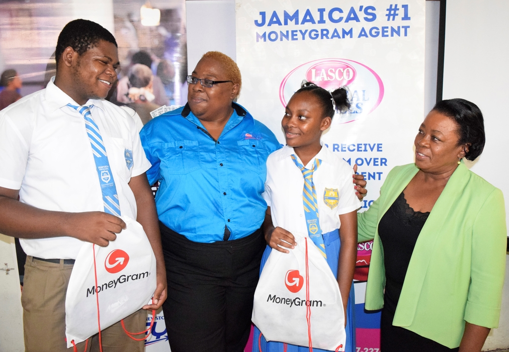 LASCO Money and MoneyGram Caribbean Secondary Education Certificate (CSEC) Scholarship Awardees D-Jaun Miller (left) and Tanikalee Harrison (second right) express their gratitude to LASCO Financial Services Brand Executive Louise-Ann Douglas (second left) during a handover on Wednesday, October 30, 2019 at the Seaforth High School. Sharing in the moment is Seaforth High School Vice Principal Sonia Aiken.