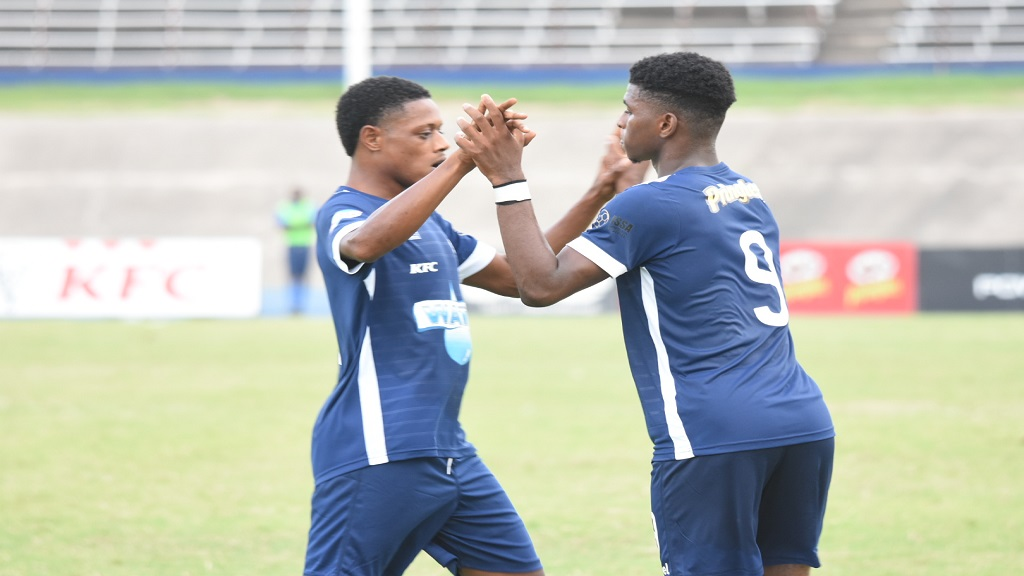 Jamaica College's Alvarez Cooper (right) celebrates one of his goals with a teammate during their Round of 16 match against McGrath High in the 2019 ISSA all-island Champions Cup knockout competition at the National Stadium on Saturday, October 2. JC won 7-0. (PHOTOS: Marlon Reid).