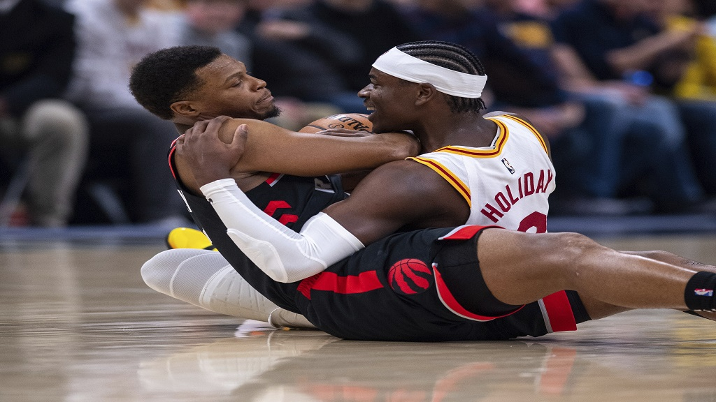 Indiana Pacers guard Aaron Holiday (3), right, and Toronto Raptors guard Kyle Lowry (7) battle for the ball during an NBA basketball game, Monday, Dec. 23, 2019, in Indianapolis. (AP Photo/Doug McSchooler).