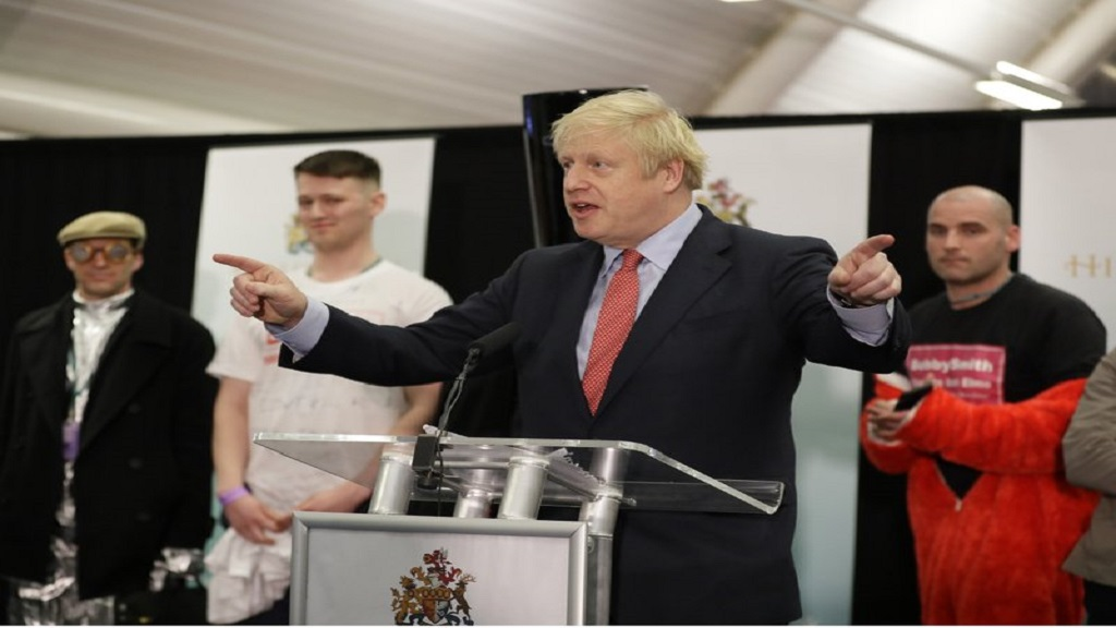 Britain's Prime Minister and Conservative Party leader, Boris Johnson (centre), gestures as he speaks after the Uxbridge and South Ruislip constituency count declaration at Brunel University in Uxbridge, London on Friday, December 13. (AP Photo/Kirsty Wigglesworth)