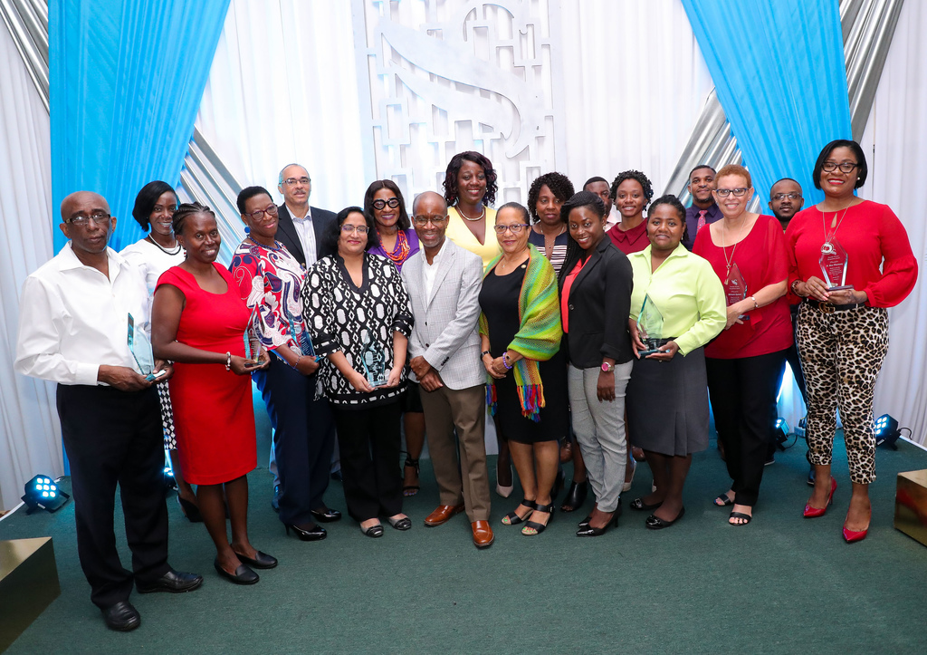 Willard Brown (5th left, front row), Executive Vice President, Employee Benefits Division, joins awardees of Sagicor Life Recognition Awards and other Sagicor representatives in a photo op, following an awards ceremony at the Golf View Hotel in Mandeville, to recognize excellence in service delivery by doctors, pharmacies and other medical practitioners.
