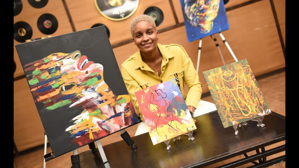 Self-taught visual artist Gabrielle Murdock at the Reggae Mill Bar recently.
