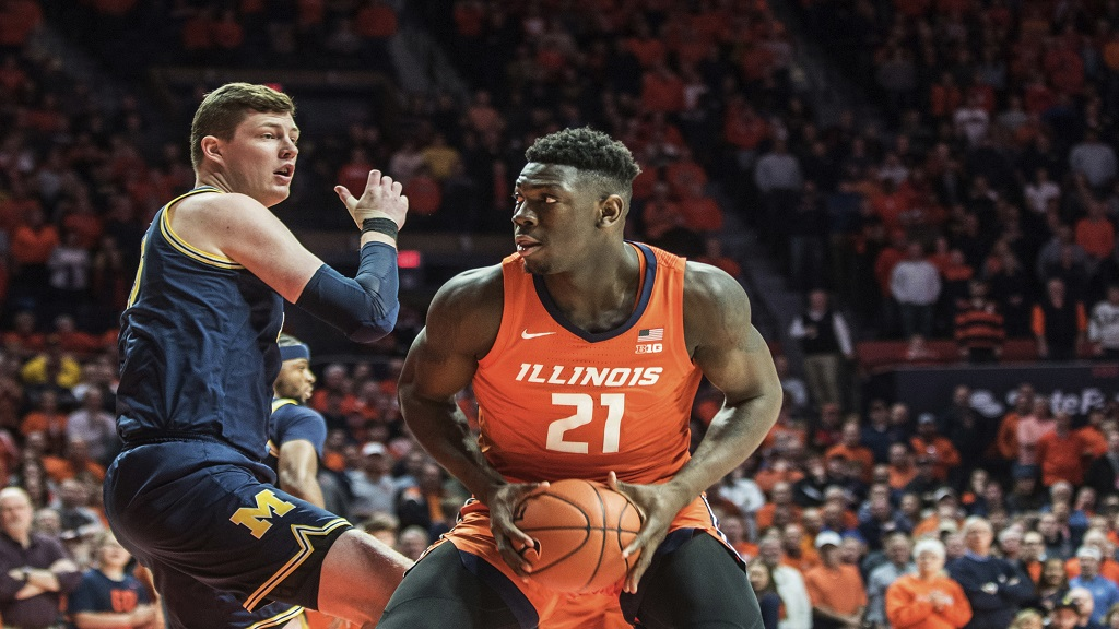 Illinois' Jamaican-born center Kofi Cockburn (21) looks to shoot as Michigan's Jon Teske (15) defends in the first half of an NCAA college basketball game, Wednesday, Dec. 11, 2019, in Champaign, Ill. (AP Photo/Holly Hart)