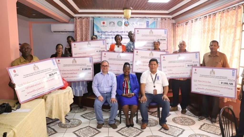 Recipients of UNDP's Micro-Grants. Also seated are UNDP Resident Representative, Jairo Valverde (left), Minister within the Ministry of Agriculture with responsibility for Rural Affairs, the Hon. Valerie Adams-Yearwood (center) and Jason Chacon, Project Manager. Photo Ministry of Agriculture
