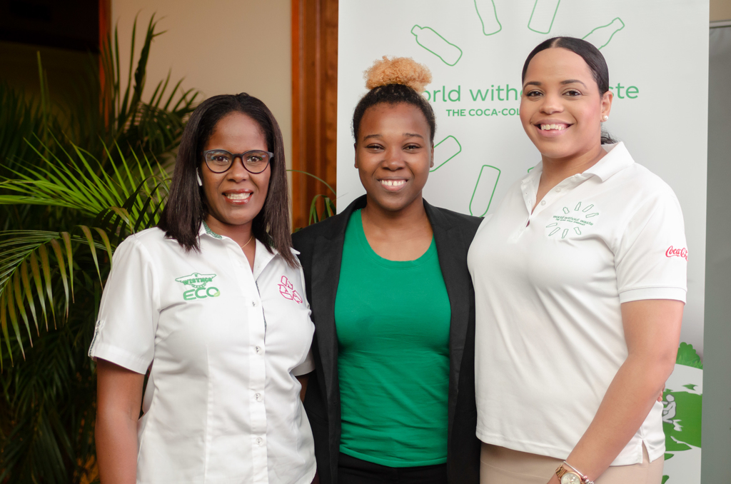 Environment Communication Officer (ECO) at Wisynco Group Limited, Shelly Ann Dunkley (left) and Coca-Cola Jamaica Brand Manager, Amoye Phillpotts-Brown (right) share a congratulatory moment with Team Lead of the Leslie Robinson Hall, Shajunee Gumbs for presenting the winning proposal during the Coca-Cola World Without Waste Campaign presentations.