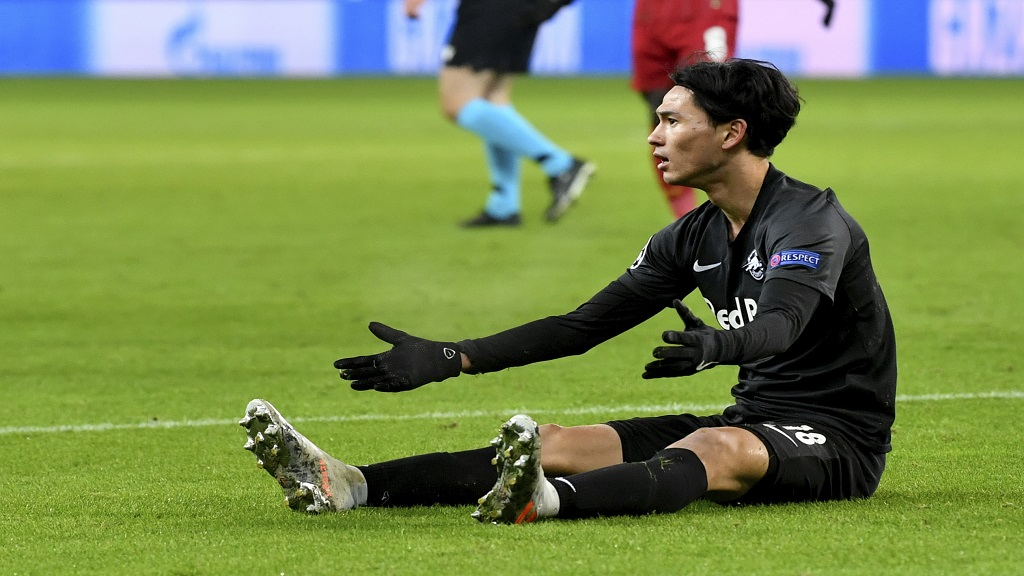 Salzburg's Takumi Minamino reacts during the group E Champions League football match against Liverpool, in Salzburg, Austria, Tuesday, Dec. 10, 2019. (AP Photo/Kerstin Joensson).