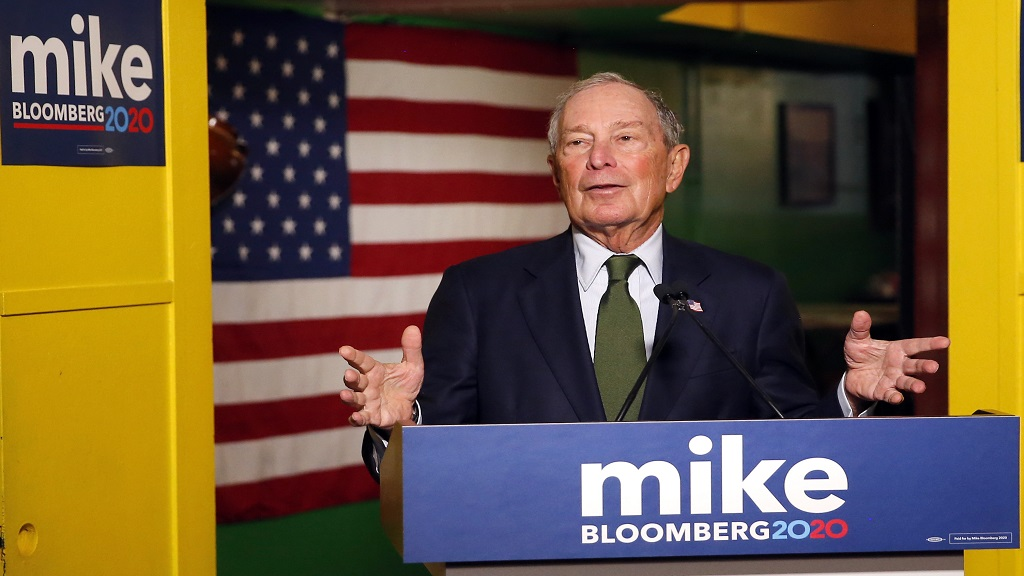 In this Nov. 26, 2019, file photo, Democratic presidential candidate Michael Bloomberg speaks to the media in Phoenix. Democrats are narrowing Donald Trump's early spending advantage, with two billionaire White House hopefuls joining established party groups to target the president in key battleground states that are likely to determine the outcome of next year's election.(AP Photo/Rick Scuteri, File)