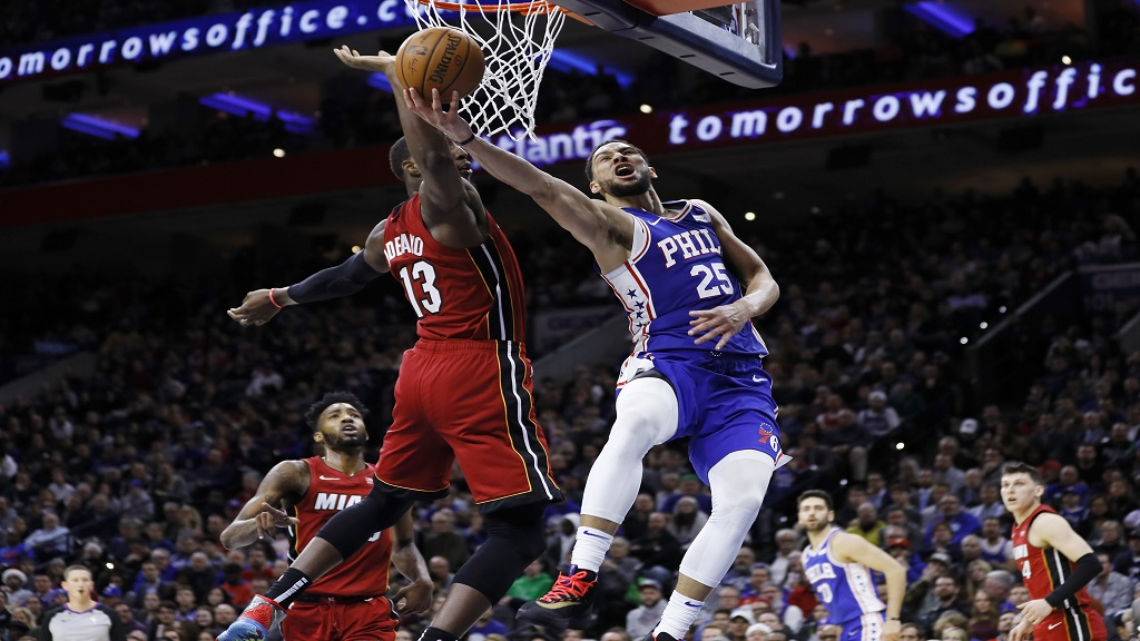 Philadelphia 76ers' Ben Simmons, right, goes up for a shot against Miami Heat's Bam Adebayo during the second half of an NBA basketball game, Wednesday, Dec. 18, 2019, in Philadelphia. (AP Photo/Matt Slocum).