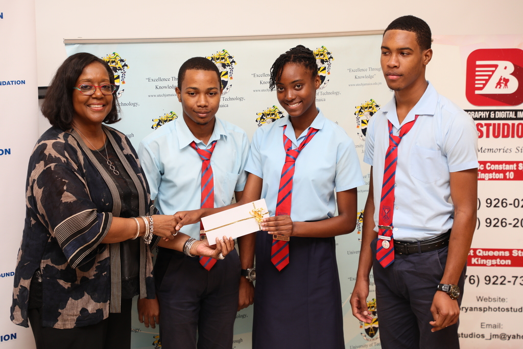 Marcia Erskine (left), Public Relations Consultant representing CIBC First Caribbean International Bank, presents a gift certificate to Knox College students (2nd l-r) Raheem Wilson, Ruth-Ann Blair and Niguel Walker, the champion team of the 3rd Annual University of Technology, Jamaica Mathematics Quiz Competition.