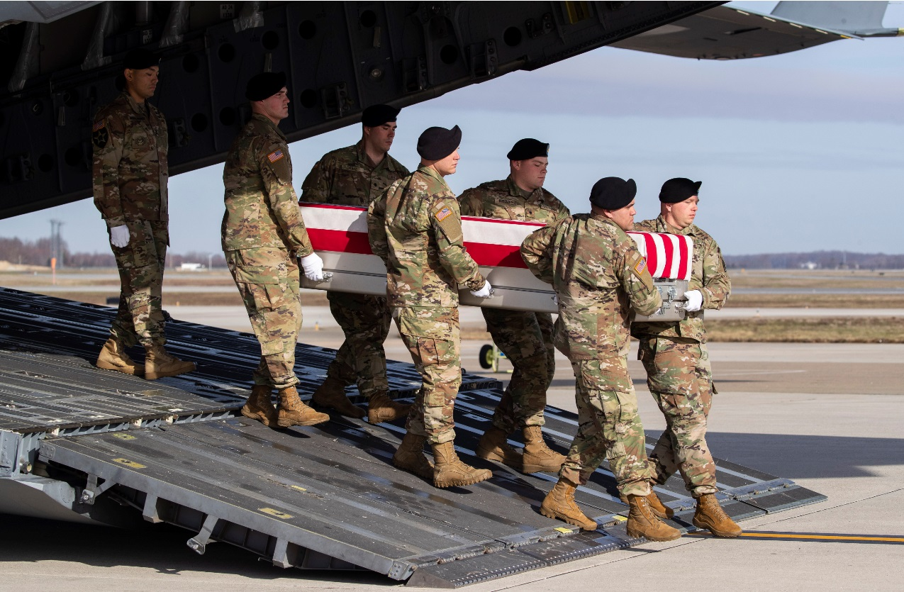 In this Dec. 25, 2019, file photo, an Army carry team moves a transfer case containing the remains of U.S. Army Sgt. 1st Class Michael Goble, at Dover Air Force Base, Del.. Goble, a U.S. Special Forces soldier who died in Afghanistan this week, was seizing a Taliban weapons cache when he was killed, the U.S. military said Friday. (AP Photo/Alex Brandon, File)