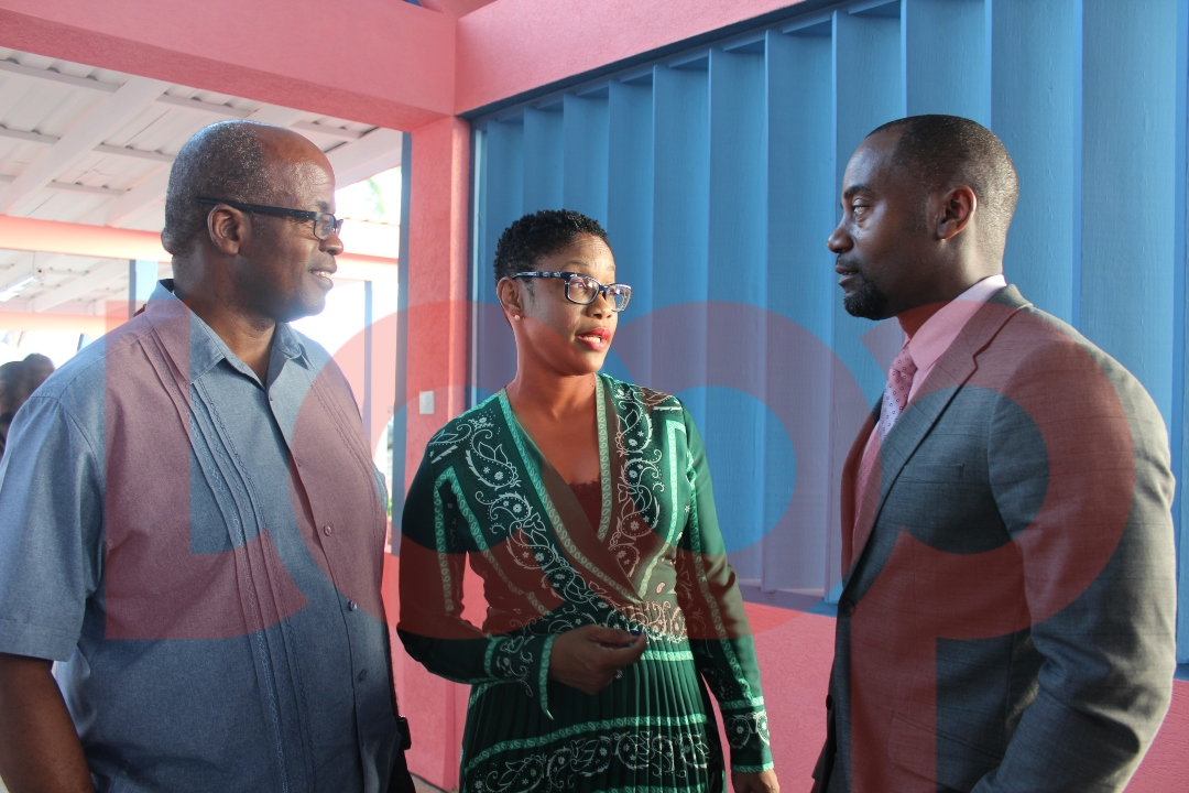 Minister Kirk Humphrey (right) in conversation with Chairman of the Barbados Port Inc. Senator Lisa Cummins and Kenneth Atherley, Divisional Manager.