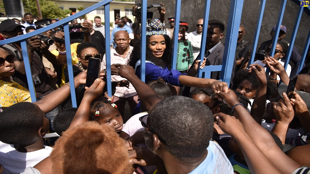 Miss World 2019, Toni-Ann Singh (centre), greets residents outside of the Women's Centre of Jamaica Foundation (WCJF) office in Morant Bay, St Thomas, during her tour of the parish on Sunday.