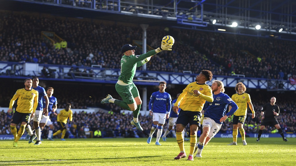 Everton goalkeeper Jordan Pickford, centre, collects the ball during the English Premier League football match against Arsenal at Goodison Park, Liverpool, England, Saturday, Dec. 21, 2019. (Anthony Devlin/PA via AP).