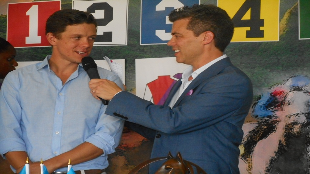 Eden Harrington (right) interviewing Michael Smith, racing manager of the RSLTC, after he made a draw on behalf of two trainers.