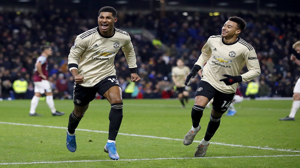 Manchester United's Marcus Rashford, left, celebrates scoring against Burnley  with team mate Jesse Lingard during the English Premier League football match at Turf Moor, Burnley, England, Saturday, Dec. 28, 2019. (Martin Rickett/PA via AP).