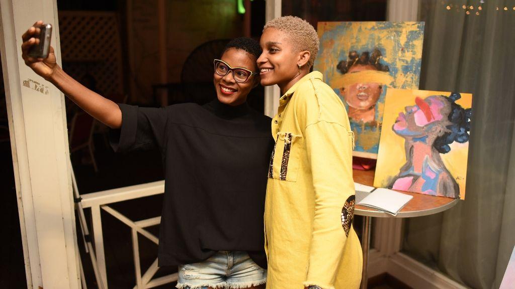 Digital artist Kianne Patrice (left) posed for a selfie with Murdock.