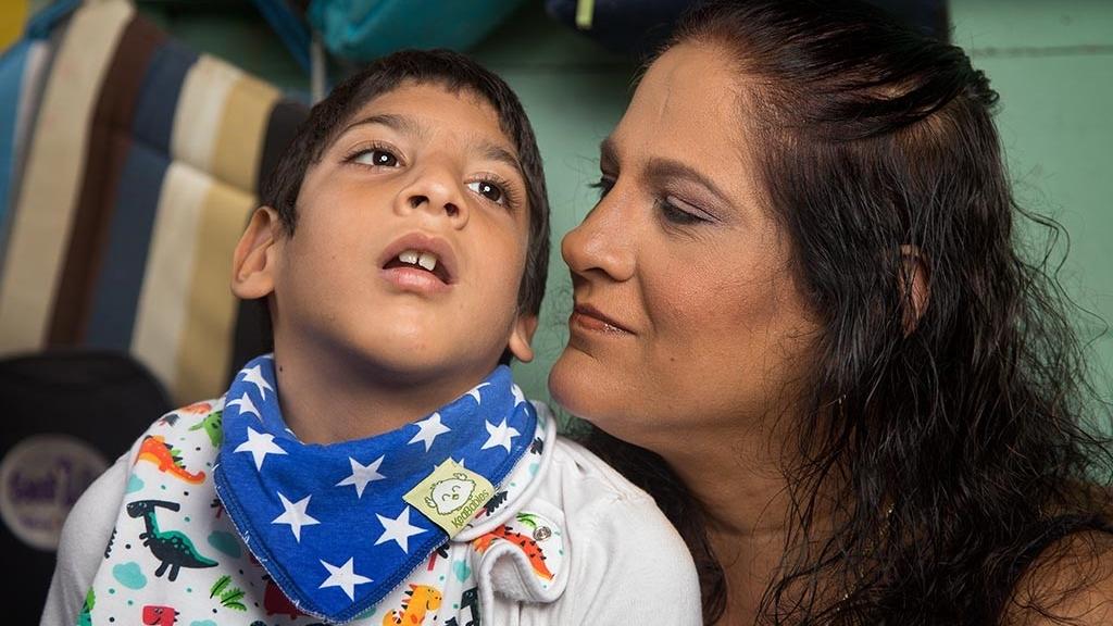 Nahlini Maharaj John and her son Joseph. Photo: Mark Lyndersay