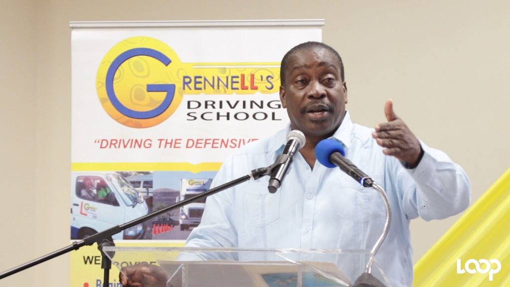 Transport Minister Robert Montague addressing audience members during the On The Road On the Job International Safety Workshop at the Jamaica Pegasus on Wednesday. (Photo: Ramon Lindsay)