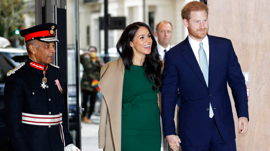 FILE - In this Tuesday, Oct. 15, 2019 file photo, Britain's Prince Harry and Meghan, Duchess of Sussex arrive to attend the WellChild Awards Ceremony in London. (AP Photo/Kirsty Wigglesworth, file)