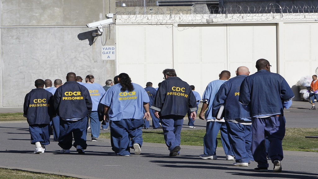 In this February 26, 2013, file photo, inmates walk through the exercise yard at California State Prison Sacramento, near Folsom, California. (AP Photo/Rich Pedroncelli, File)