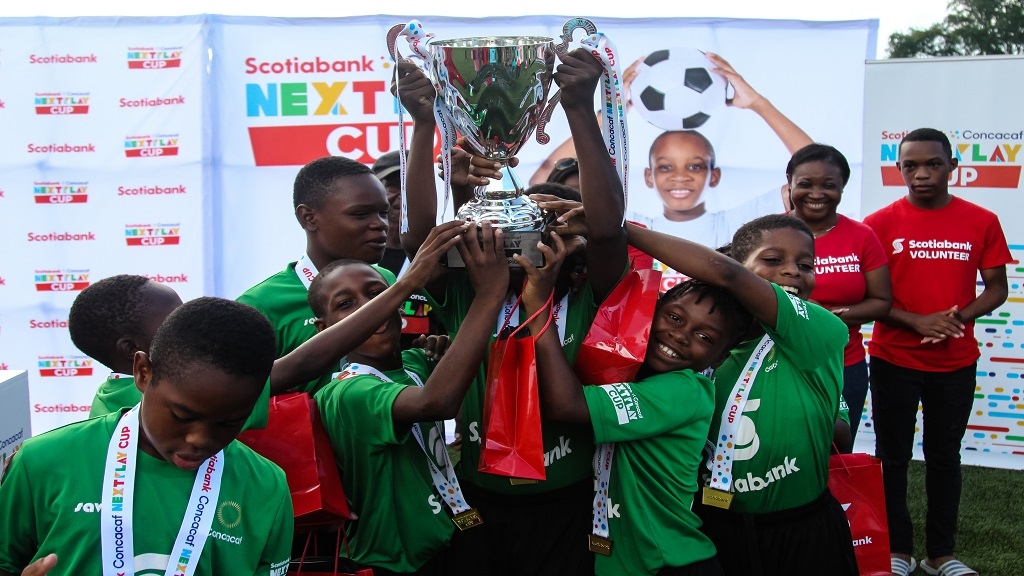Members of May Pen Primary football team celebrate with the NextPlay Cup after beating Holland Primary 3-1 on penalties in the Jamaica leg of the the 2019 Scotiabank Concacaf NextPlay Cup final at the UWI/JFF Captain Horace Burrell Centre of Excellence on Saturday, December 7, 2019.