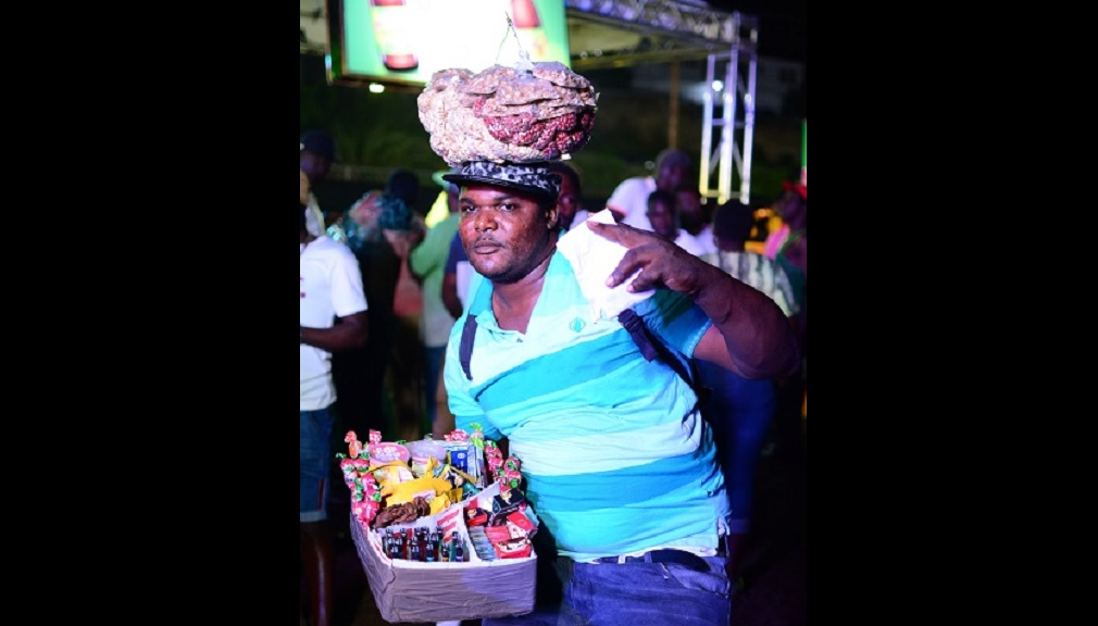 Peanut vendor Donovan Grant is in high spirits having won $30,000 at the Magnum Big 20 Party at Addison Park, Brown's Town, St Ann.