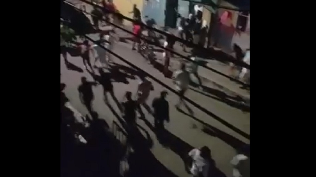 Screen grab of video showing people fleeing amid a shootout at a party in Rockfort.