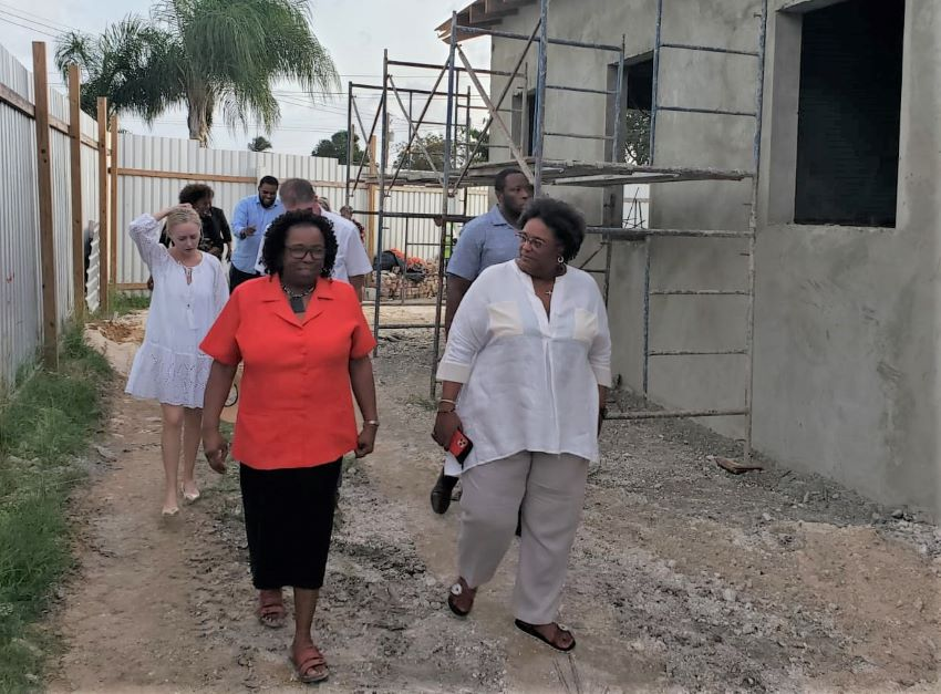 PM Mottley (right); Director of the Child Care Board, Joan Crawford(left), and officials touring the Nightingale Children's Village expansion project.​ (BGIS)