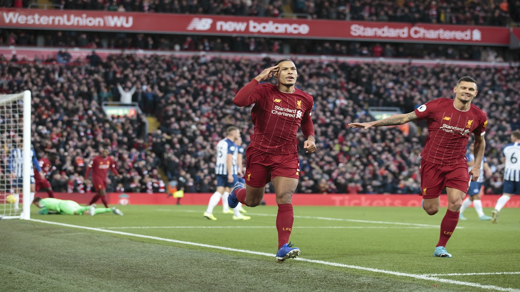 Liverpool's Virgil van Dijk celebrates after scoring during the English Premier League football match against Brighton at Anfield Stadium, Liverpool, England, Saturday, Nov. 30, 2019. (AP Photo/Jon Super).