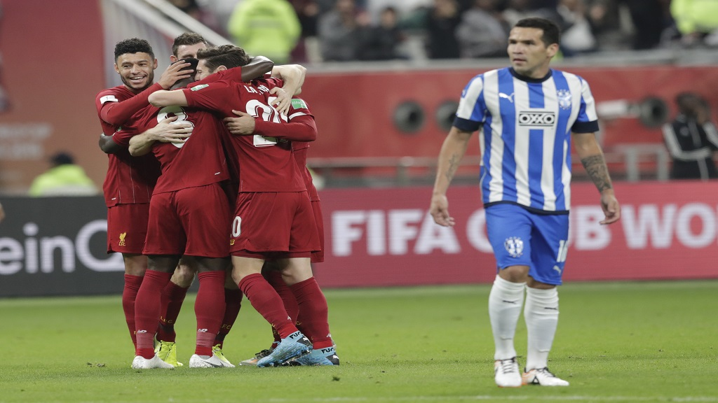 Liverpool's players celebrate after a goal during the Club World Cup semifinal football match against Monterrey at the Khalifa International Stadium in Doha, Qatar, Wednesday, Dec. 18, 2019. (AP Photo/Hassan Ammar).