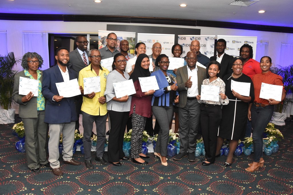 Graduates of the rain water harvesting and grey-water recycling get thumbs up from Senator Pearnel Charles (fourth right), Minister in the Ministry of Economic Growth and Job Creation and Onyka Barrett Scott (fifth from right), general manager of the JN Foundation.