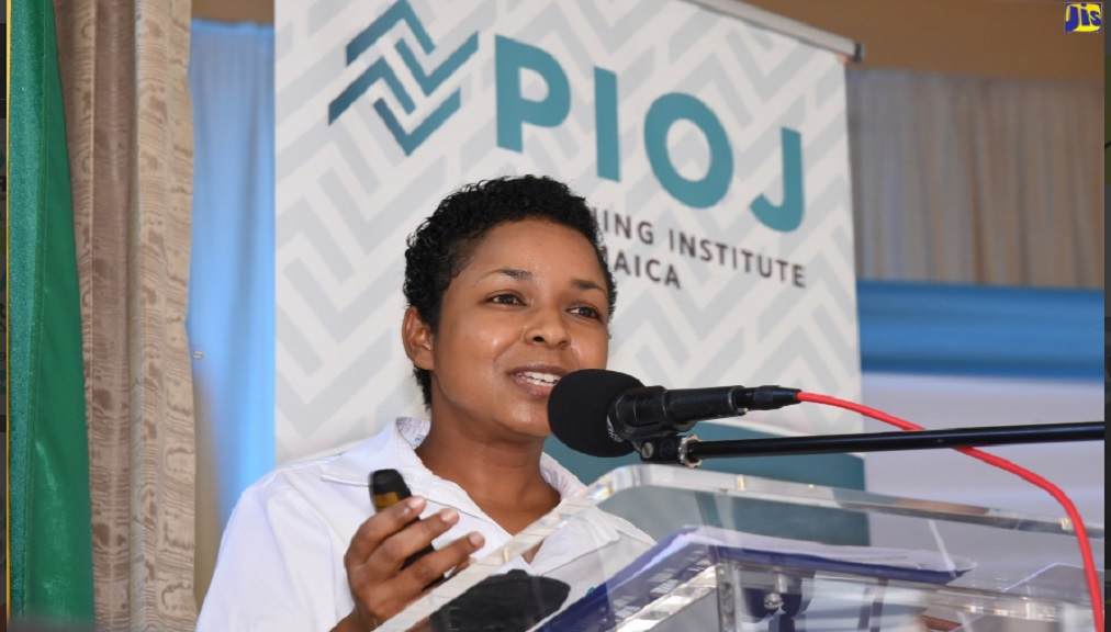Social Protection Analyst at the Planning Institute of Jamaica (PIOJ), Camille Graham, speaking at the PIOJ's 'Dialogue for Development Series' public consultation at the St. John's Anglican Church in Ocho Rios, St. Ann.