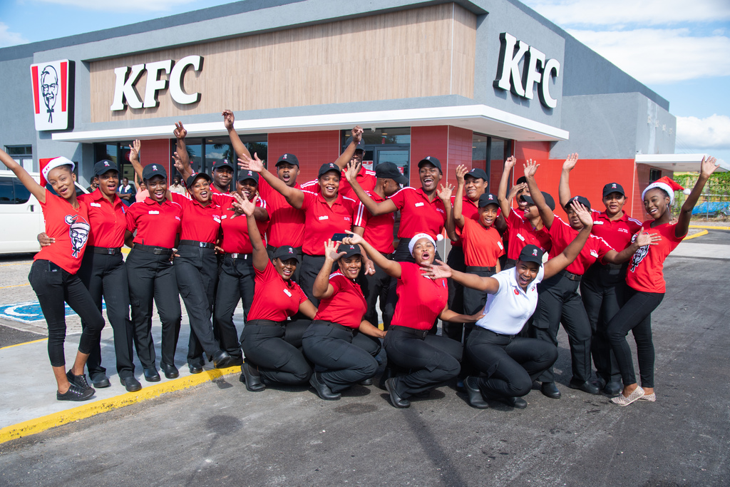 The amazing team members of Pizza Hut Falmouth stand proudly by the new restaurant.