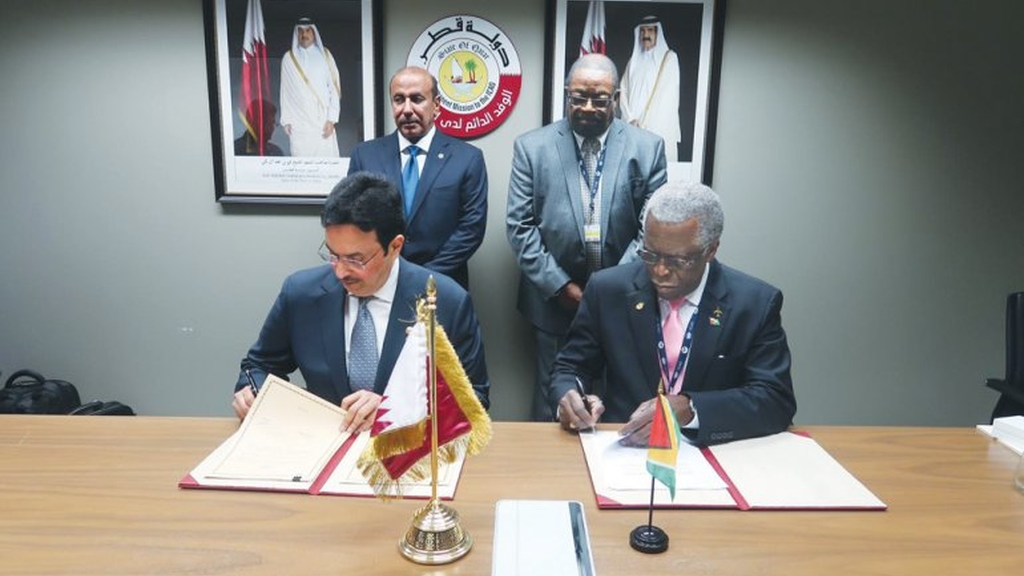 Minister of Transport and Communications, H E Jassim bin Saif Al Sulaiti, and Chairman of the Guyana Civil Aviation Authority (GCAA) Board, Lawrence London, witnessing the signing of the agreement.