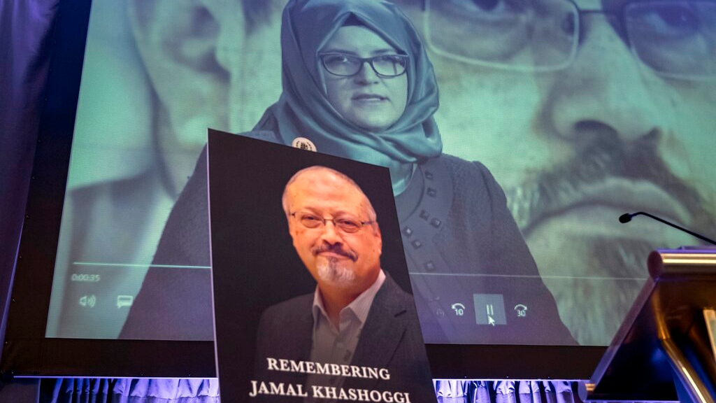 FILE - In this November 2, 2018 file photo, a video image of Hatice Cengiz, fiancee of slain Saudi journalist Jamal Khashoggi, is played during an event to remember Khashoggi, who died inside the Saudi Consulate in Istanbul on October 2, 2018, in Washington. (AP Photo/J. Scott Applewhite, File)