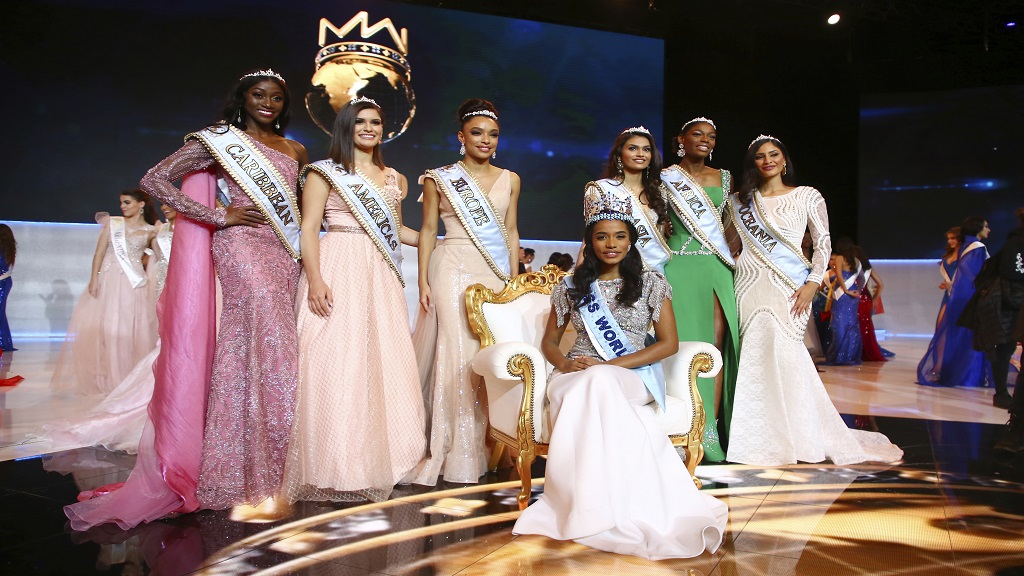 Winner of Miss World 2019, Toni-Ann Singh of Jamaica, front centre, poses for photographers in front of the other finalists, at the 69th annual Miss World competition at the Excel centre in London Saturday, Dec 14, 2019. Tourism Minister Ed Bartlett says Jamaica will be inviting Miss Nigeria, Nyekachi Douglas (second right) and Miss India, Suman Rao (third right) to visit the country.