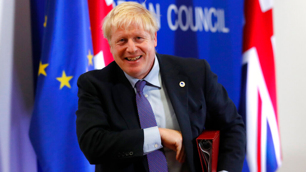 British Prime Minister Boris Johnson leaves the podium after addressing a media conference at an EU summit in Brussels, October 17, 2019. (AP Photo/Frank Augstein)