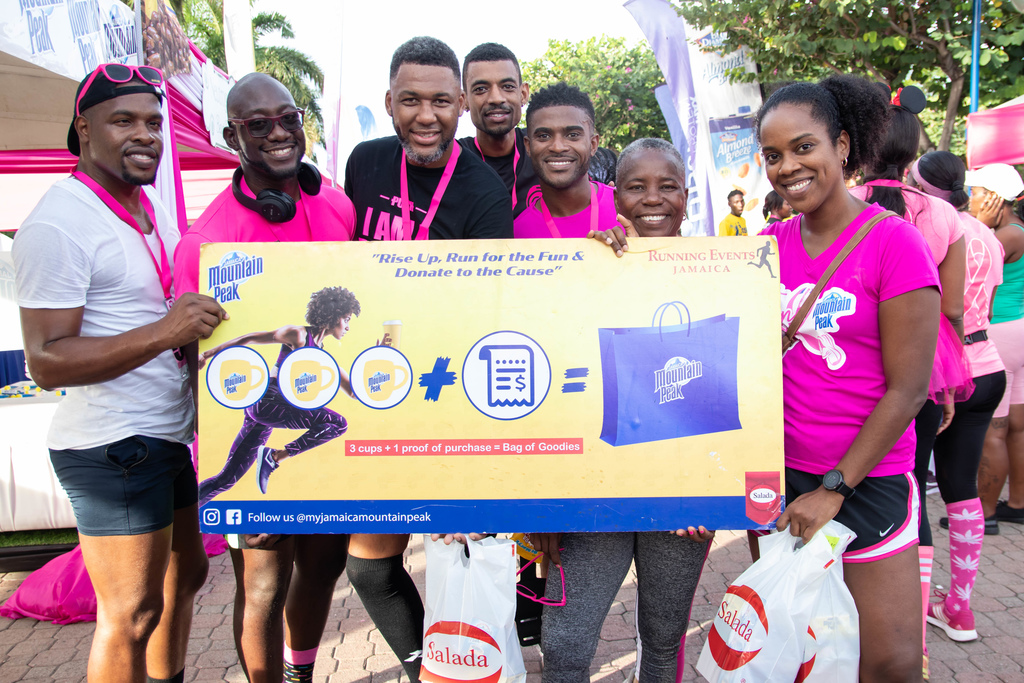Tamii Brown (right), commercial and corporate affairs manager at Salada Foods Jamaica celebrates with a few of the Salada Rise Up and Run winners at the ICWI Reach to Recovery Pink Run at Emancipation Park on Sunday, October 27, 2019.