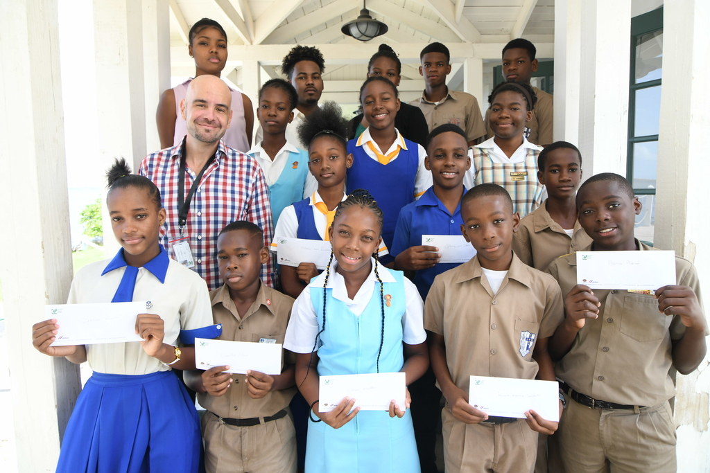 Scholarship recipients from the Bull Bay Commuunity with Carib Cement General Manager Yago Castro