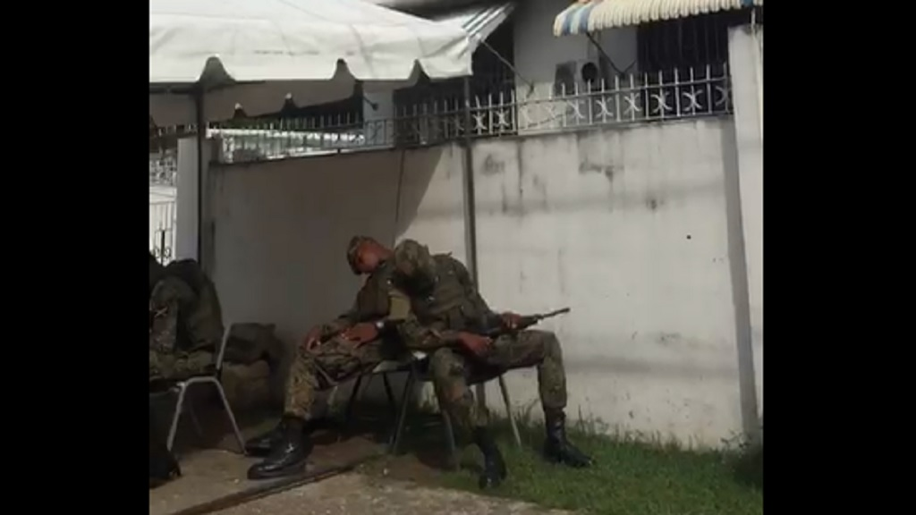 Screen grab of a video purportedly showing soldiers sleeping at a state of emergency checkpoint in the Corporate Area.