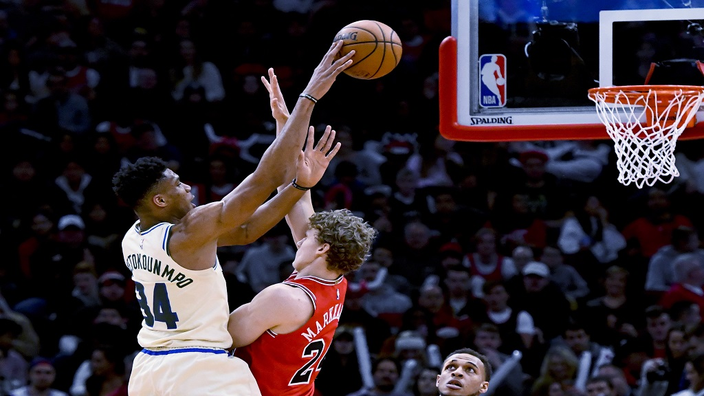 Milwaukee Bucks forward Giannis Antetokounmpo (34) shoots over Chicago Bulls forward Lauri Markkanen (24) during the first half of an NBA basketball game, Monday, Dec. 30, 2019, in Chicago. (AP Photo/Matt Marton).