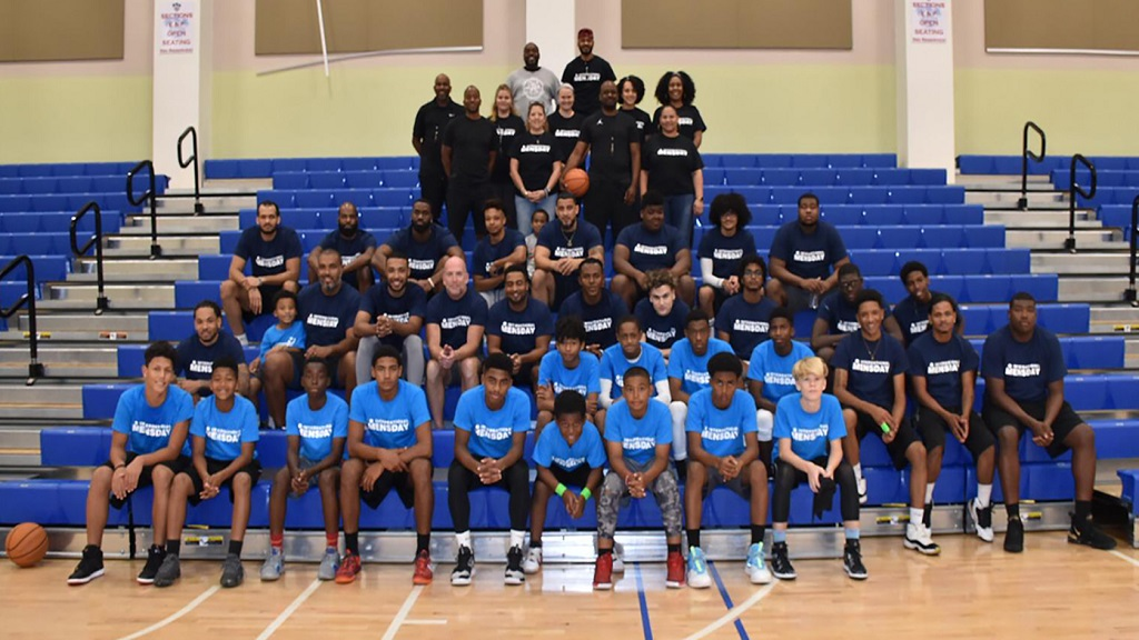nternational Men's Day Basketball tournament players (men in navy/U16s in blue) and Family Resource Centre organisers. The Intergenerational event was held at John Gray High School's new gym.