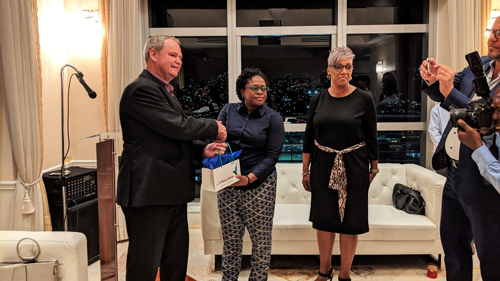 Photo L-R: Dutch Charges d'Affaires Cor Stouten receives a gift from Caribbean Airlines Head of Corporate Communications, Dionne Ligoure on the establishment of the new Trinidad and Tobago-Curacao route.
